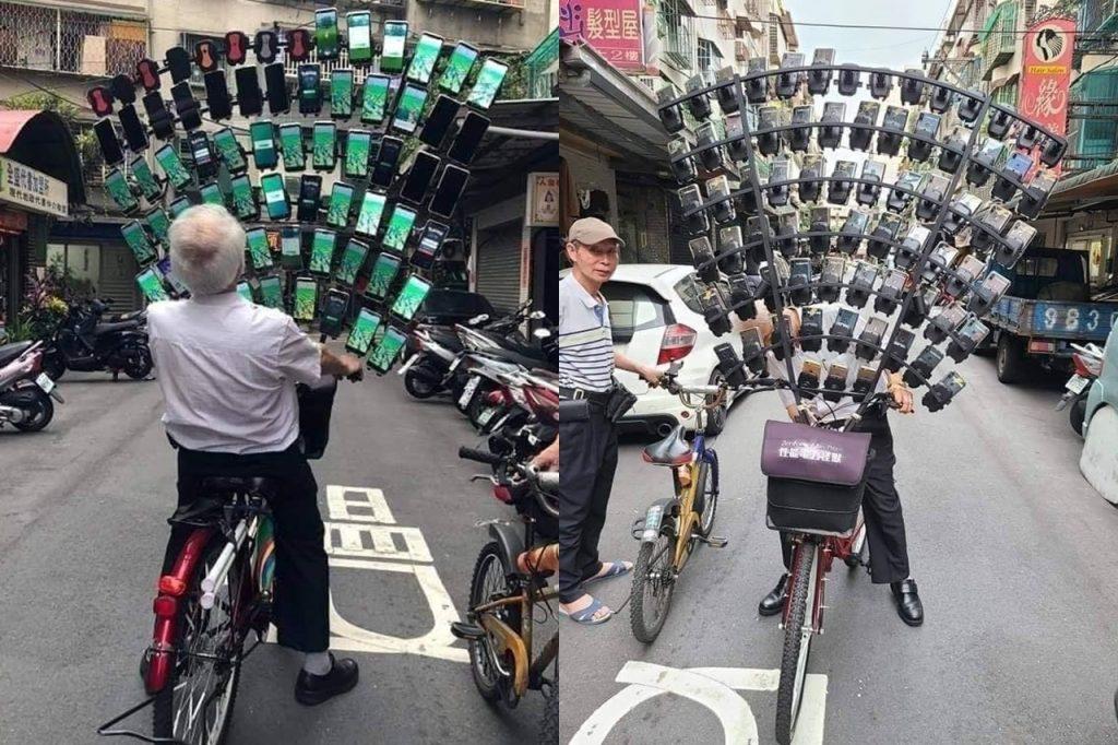 鐵馬上宛若孔雀開屏的六十幾支手機抓寶阿伯(圖片來源:聯合新聞網,取自爆廢公社公開版截圖)